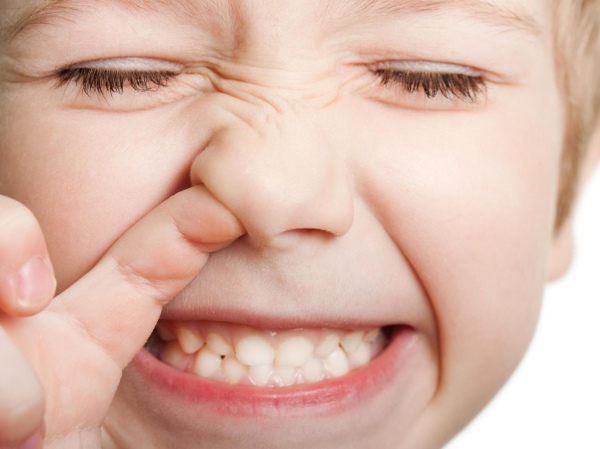 Close-eyed kid picking nose with his mouth open